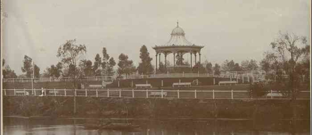 Image: A rotunda sits on a hill in a landscaped park on the bank of a river