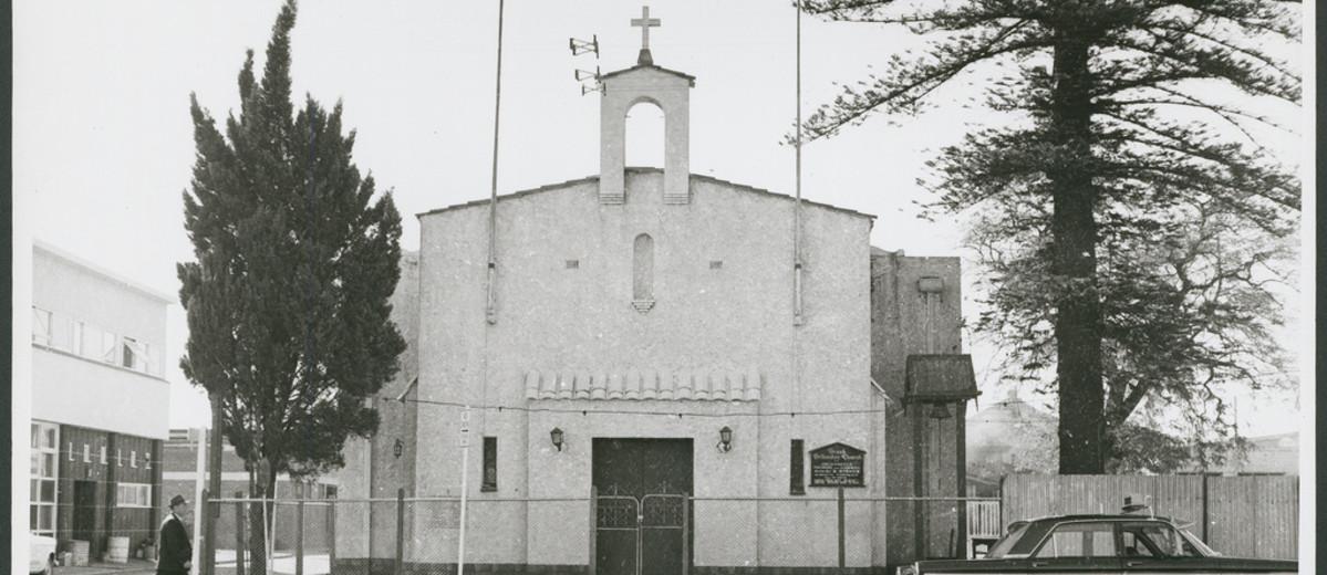 Image: street view of white stone church
