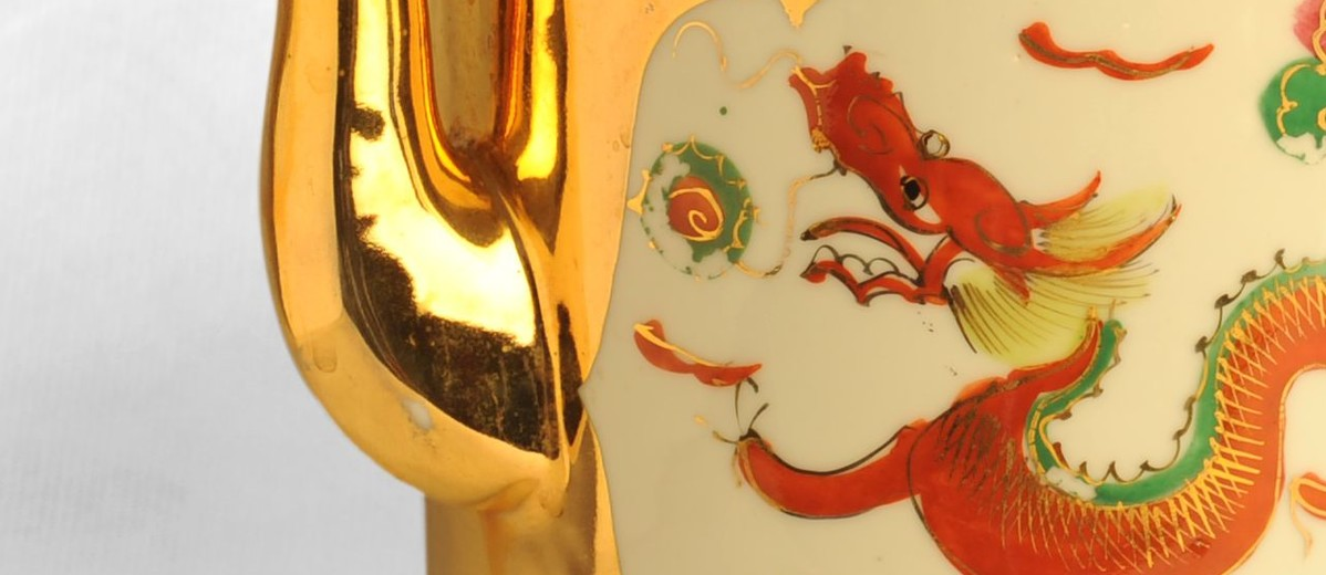 Image: red painted dragon on gold teapot