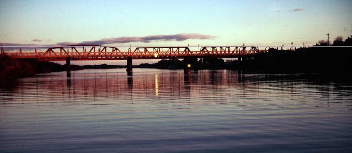 Image: bridge over river at sunset