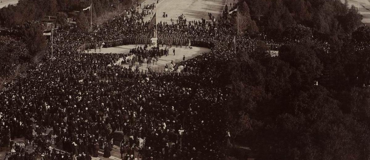 Image: crowds of people around sculpture in public square