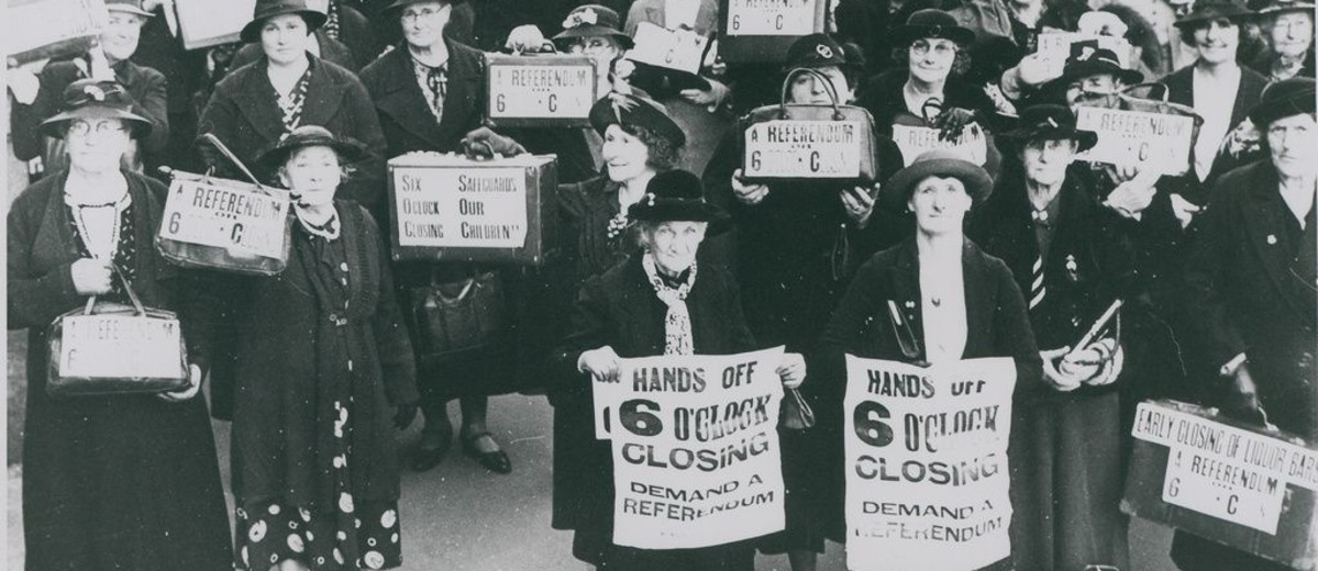 Image: group of women holding posters
