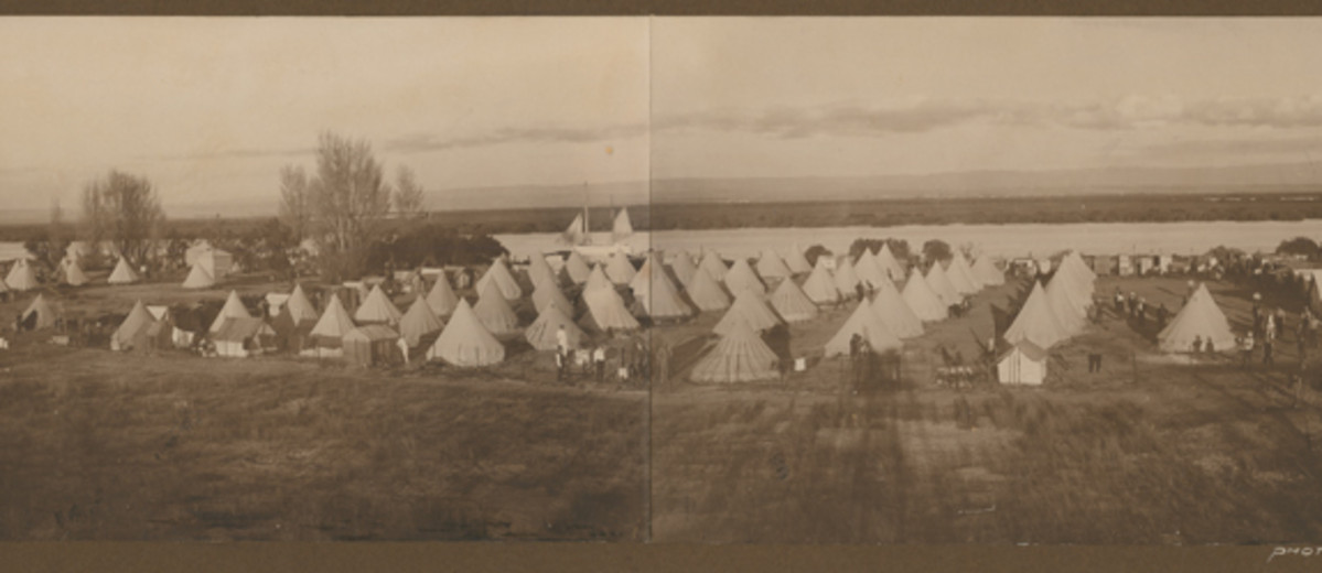 Image: black and white photo of group of tents
