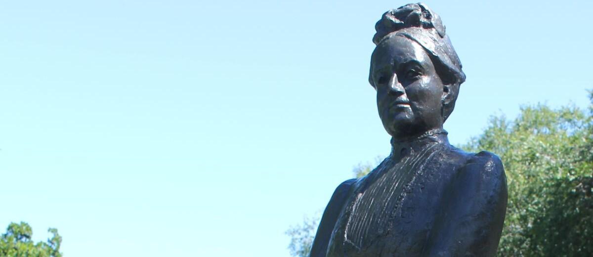 Image: bronze sculpture of woman standing