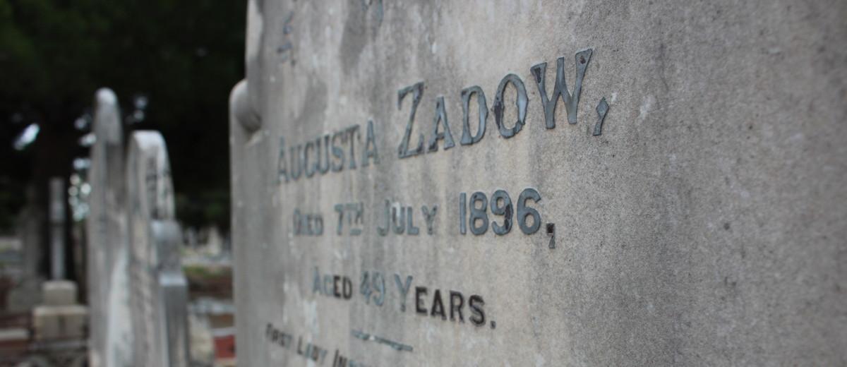 Image: engraved grey stone grave headstone