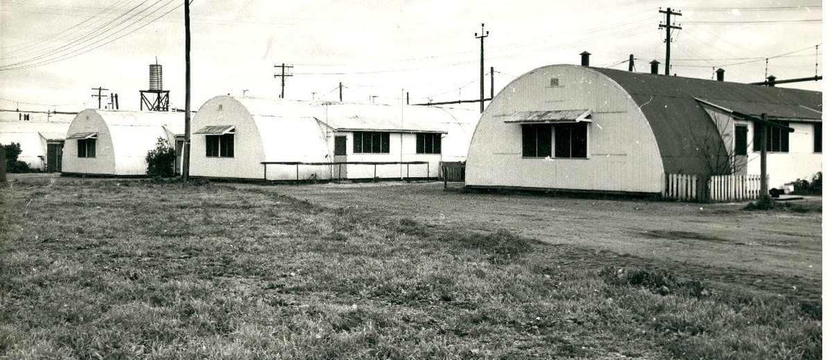 Image: row of curved tin buildings