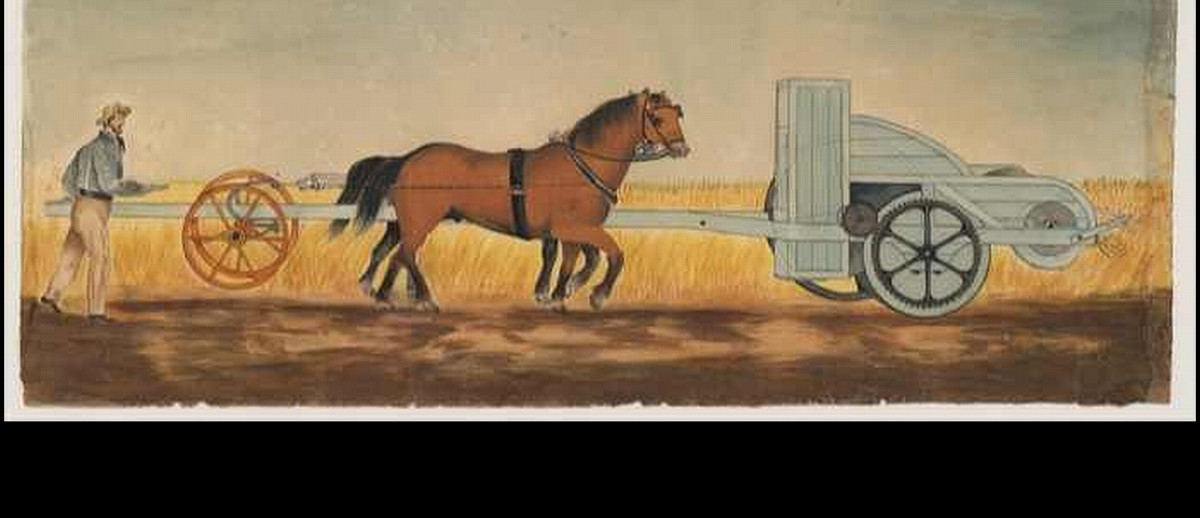 Image: A hand-drawn and coloured picture of a man in early 19th-century attire operating a machine for reaping wheat. The machine is attached to two harnessed horses, who are pushing it through a wheat crop