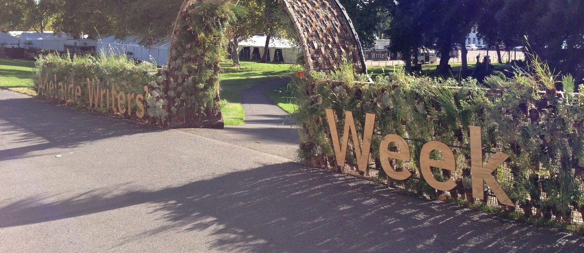 Image: arch at entrance to garden with pathway down grassed slope