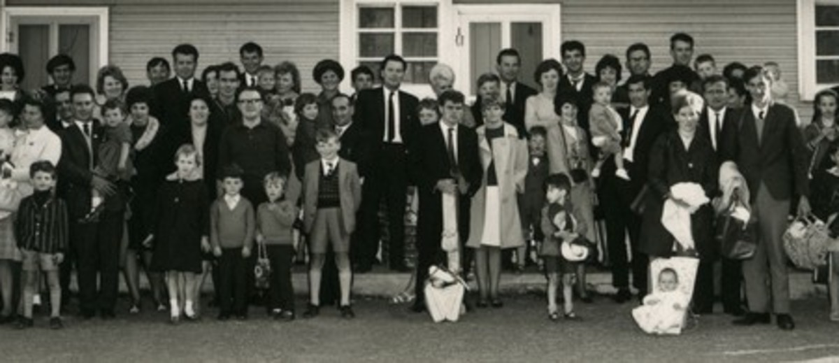 Image: large group of people in front of building