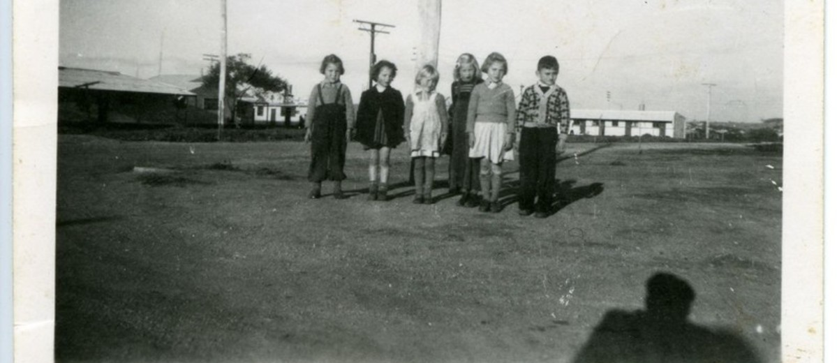 Image: group of children with buildings in background