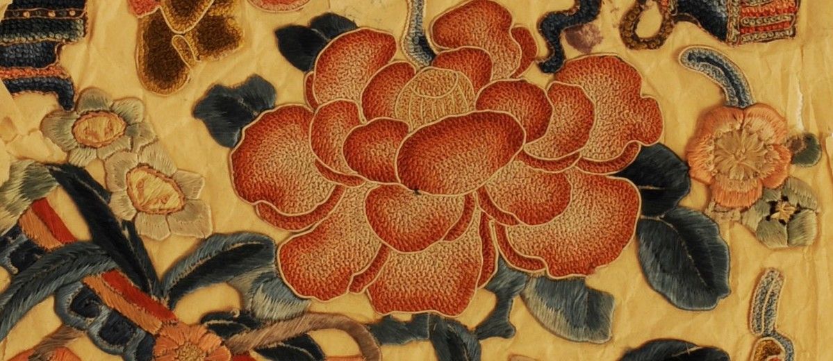 Image: embroided rose on cream paper
