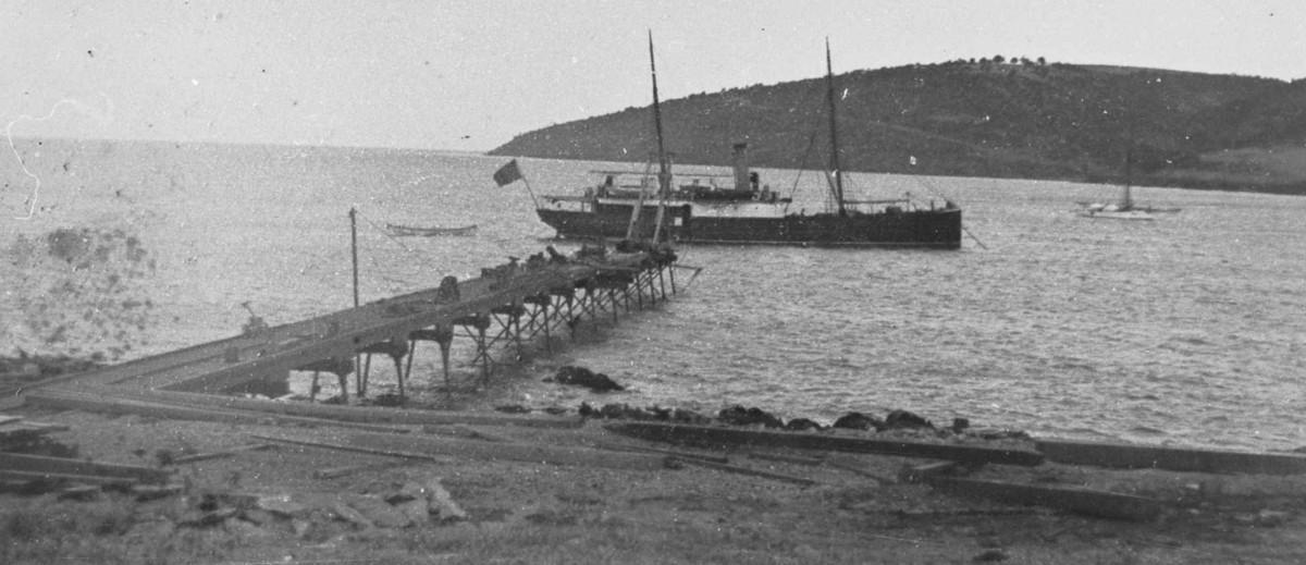 Image: boat in water near jetty on island