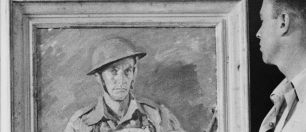 Image: A man standing holding a paintbrush and a cloth, looking at a framed painting of a soldier, the painting is on an easel