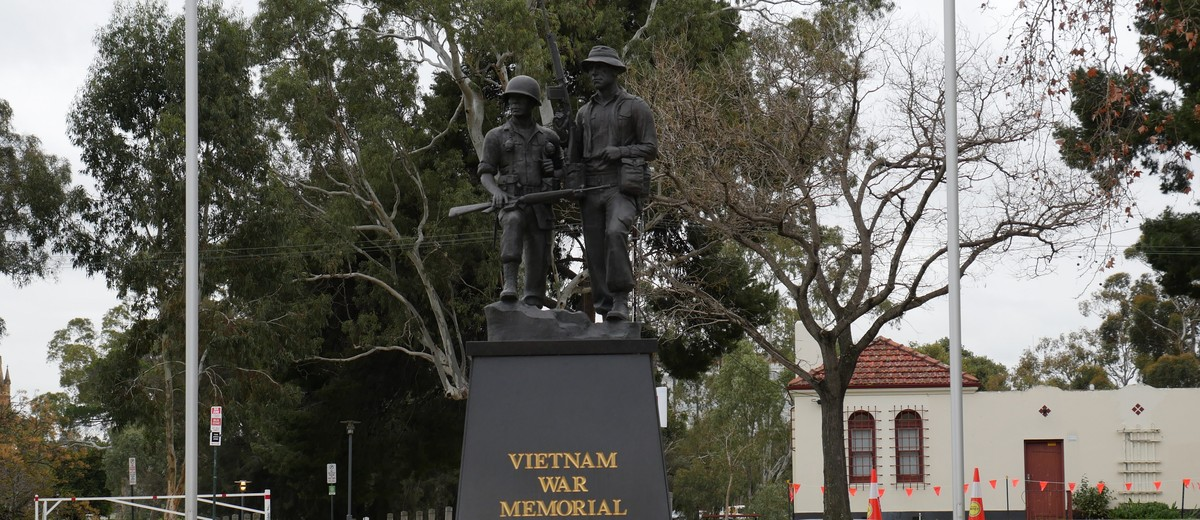 Image: Black memorial monument for the Vietnam War, front of memorial.