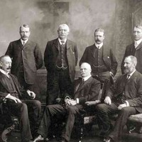 Image: Group portrait of men in suits