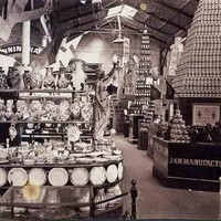 Image: large displays of artfully arranged crockery, vases, jam jars and other items fill a large hall.
