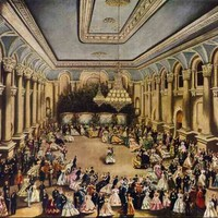 Image: couples in 1860s dress (the women's' gowns in a range of colours and the men mostly in black) dance in a large ballroom with columns lining the walls and large chandeliers hanging from the tray ceiling.