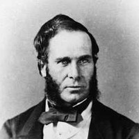Image: Black and white portrait of a man with heavy sideburns