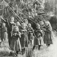 Image: Children dancing around a maypole