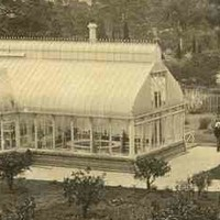 Image: Sepia photograph of conservatory building and residence