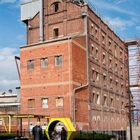 Image: large red brick building several stories high