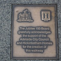 Image: bronze plaque with logos and text