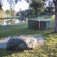 image: rectangular stone memorial and smooth stone bench