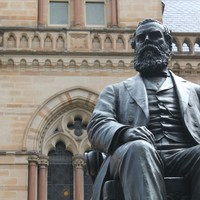Image: large bronze statue of seated man