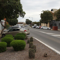 Bitumen roadway with old stone and brick buildings either side