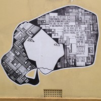 Image: black and white decal of a woman's face with geometric shapes and text