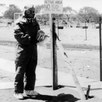Image: man in protective clothing at Maralinga