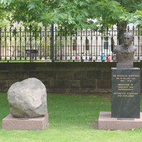 Bronze bust of Douglas Mawson by John Dowie, 1981 with boulder from Mawson, Antarctica