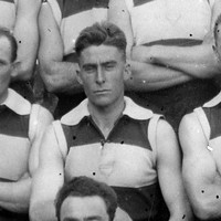 Image: A group of young Caucasian males in 1920s-era Australian Rules Football uniforms pose for a photograph