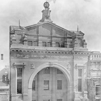 Image: large building with ornate arched entrance