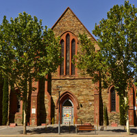 Image: stone church building with high central steeple