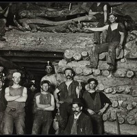 Image: Men working in mine pose for photograph