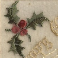 Image: embroidered holly, buildings and trees