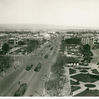 Image: view of cityscape with trams and garden squares in foreground