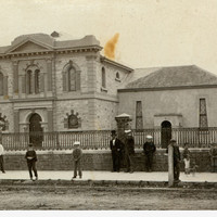 Image: people standing in front of buildings