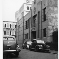 Image: view of cars parked in front of building