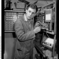 Image: Young man operating machinery