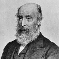Image: A lithographic portrait of a middle-aged balding man with a large, full beard. He is wearing mid-Victorian attire, including an overcoat, waistcoat, and pocket watch chain with fob