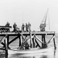 Image: men on a jetty
