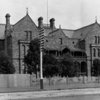 Three storey masonry building with three gable ends