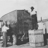 Image: two men washing a large van