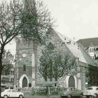 Image: three cars parked outside stone church