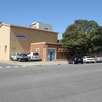 Image: Two storey building on street corner