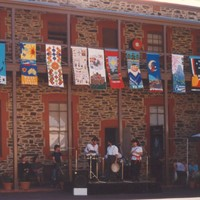 Image: building displaying banners from first floor balcony