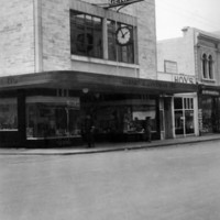 Image: Storefront featuring clock on main street. Sign reads 'Gerard and Goodman Limited'