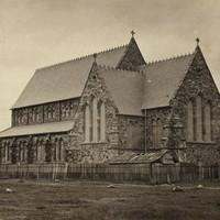 Image: Gothic Revival church near a tree